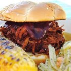 Slow Cooker Texas Pulled Pork - Texas-style pulled pork simmers in a tangy chili-seasoned barbecue sauce with plenty of onion, then pulled into tender shreds to serve on a buttered, toasted bun.