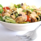 Grandma's Easy Turkey Taco Salad - Seasoned ground turkey is tossed with black beans, lettuce, tomato, tortilla chips, and dressing.