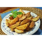 Cajun Potato Wedges - Seasoned potato wedges are baked in the oven instead of deep fried. A fun alternative to french fries.