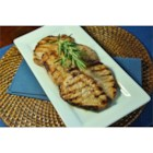 Andrew's Favorite Grilled Pork Chops - Start these thick grilled pork chops ahead of time, marinating in the simple but flavorful mixture of orange juice and soy sauce with green onions. Then making dinner will take just a few minutes.