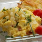 Green Garlic and Ham Scrambled Eggs with Cheese - Scrambled eggs with ham, garlic scapes, onion, and white Cheddar cheese make this a delicious egg dish for any meal.