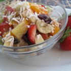 Ann's Fantastic Fruit Salad - This colorful and citrus-y fruit salad has a hint of shredded coconut and walnuts for a refreshing tropical salad.