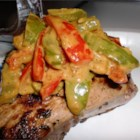 Steak au Poivre with a Curry Twist - Tender steaks flavored with garlic and crushed black peppercorns are served in a light and colorful curry sauce with red, green, and yellow bell peppers.