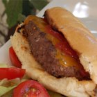 All-American Burger Dog - The tastiness of a burger in the shape of a hot dog makes the burger dog the best of both worlds for your next summer cookout.