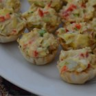Crab and Artichoke Tarts - This creamy, savory tart is loaded with crabmeat, artichoke hearts, and red bell peppers for a quick and easy appetizer.