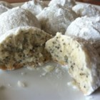 Poppy Seed Tea Cakes  - Poppy seeds add crunch and richness to these bite-size tea cake cookies that are rolled in powdered sugar.