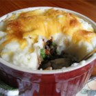 Zippy Shepherd's Pie - Gather the family round with this quick and easy shepherd's pie recipe. The meat mixture can be made ahead and frozen. You can also substitute instant potatoes for the real thing if you're in a hurry. I especially love to use white cheddar in this recipe!