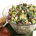 Bacon Broccoli Salad with Raisins and Sunflower Seeds - This smoky, crunchy broccoli salad has a tangy and sweet mayonnaise-based dressing. It's sure to be a family favorite.