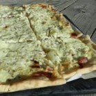 Sauerkraut on Bread Dough - A thin sheet of dough is sprinkled with bacon and sauerkraut, then drizzled with a spiced sour cream and baked until golden.  This goes really well with a crisp Riesling or German beer!
