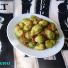 Garlic Brussels Sprouts with Crispy Bacon - Pan-fry Brussels sprouts in butter and crispy bacon for a smoky addition to your vegetable side dish. You can add a little of the bacon grease to the dish if you prefer.