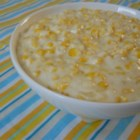 Creamed Corn - Frozen whole kernel corn and grated Romano cheese are stirred into a heavy cream sauce and then baked in a casserole in this side dish for meat, poultry or fish.
