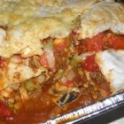 Mexican Enchilada Casserole - A layered and baked Mexican-inspired casserole is made with corn tortillas, ground turkey meat, and lots of cheese and spicy homemade enchilada sauce. Lettuce and tomato are baked right in. Look online for the requested brand of chili powder.