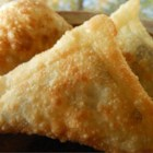 Sambusa - This is a Somali recipe. I learned it by watching my Somali friends around Ramadan and I was able to make my own variation. They are really good and I can't stop eating them. They are served during Ramadan, Weddings, Parties, or just because. A seasoned ground beef mixture is wrapped in a cone shaped package and deep fried. For a variation you can substitute shredded beef for ground beef.