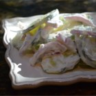 Simple Cucumber Salad - Cucumber and onion in a sour cream and vinegar dressing makes a simple and quick cucumber salad.
