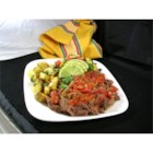 Colombian Stewed Flank - Flank steak is simmered for 2 hours in a delicious stew with onions, tomatoes, and garlic.