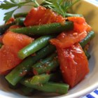 Steamed Green Beans with Roasted Tomatoes - Garlicky roasted tomatoes combine with fresh steamed green beans for a side dish that tastes like summer.