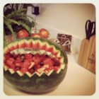Watermelon Fruit Salad Bowl - Lightly sweetened melons, grapes and tropical fruits are served in a carved watermelon-rind 'bowl'. Try cutting a scalloped, or sawtooth, rim around the edge of the watermelon for a special presentation.