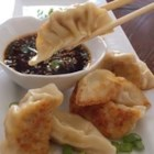 Chinese Pork Dumplings - Fill store-bought wonton wrappers with a flavorful pork mixture for authentic tasting dumplings at home.