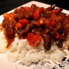 Spicy Crispy Beef - Deep fried strips of flank steak, sauteed with onion and red pepper in a spicy but sweet soy sauce. Serve with steamed rice and vegetables.