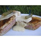 Croque Monsieur - This delicious and classy sandwich is a twist on the traditional recipe by substituting Gouda for Gruyere, adding a splash of white wine to the cheese sauce, and building it on San Francisco-style sourdough bread.