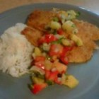 Caribbean Fish With Mango Salsa - Tilapia fillets are rolled in coconut-flavored bread crumbs with a special spice mix, then pan fried and served with mango-pineapple salsa for a Caribbean-inspired dinner. Most any mild, firm fish will work, and it's great made with scallops, too.