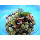 Quick Edamame Salad - This is a nice fresh and colorful salad of edamame, black beans, corn, and peas. It is tossed with a flavorful herb dressing and is perfect for lunch, picnics, or any occasion.