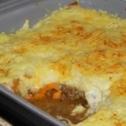 Proper English Cottage Pie - For this savory pie, ground beef, onions, veggies, herbs and spices marry perfectly: Everything is sauteed together and then combined with broth and tomato paste, and simmered until ready to pour into a prepared pie crust. The hearty filling is then topped with fluffy mashed potatoes, sprinkled with Cheddar cheese, and baked.