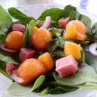 Springtime Ham and Spinach Salad - Tender spinach, ham, cantaloupe, and sweet bits of peaches all mingle with a tangy fruit-tinged vinaigrette in this tasty salad.