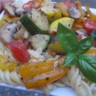 Summer Penne Pasta - Red, green and yellow bell peppers are lightly sauteed along with a succession of zucchini, yellow squash, mushrooms and garlic. Add chopped tomatoes and serve over freshly boiled pasta.