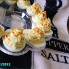 Fully Loaded Deviled Eggs - Savory deviled eggs loaded with Cheddar cheese and bacon bits make a nice appetizer or a light meal.