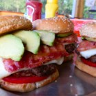 The Labor Day Burger - Enjoy the last sweet weekend of the summer with this deluxe cheese-stuffed burger served on buns with tomato and avocado slices. The recipe makes two large servings.
