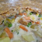 Chicken Pot Pie with Cheddar Crust - Tender chicken pieces are mixed with potatoes, carrots, celery, onion, parsley, and green onions before being tossed in a made-from-scratch cream sauce and tucked under a Cheddar cheese-seasoned crust, then baked to perfection.