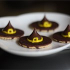 Witches' Hats - Tasty little cookie and candy snacks look just like pointy witch hats. They are so easy a kid can help. Little bows made from decorating gel add to their spooky effect.