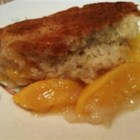 Great Grandma's Peach Cobbler - Canned peaches makes this dessert a year-round treat. Serve it warm with a scoop of ice cream. It tastes great cold too!