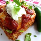 Mexican Lasagna Lite - Mexican-inspired light ingredients including refried beans, prepared enchilada sauce, sour cream, and ground turkey are layered like a lasagna and baked for a lower-fat version of the popular casserole.