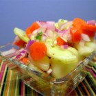 Zippy Cucumber Salad - This spicy, tangy, cold, and yummy version of an old favorite will cool you off while heating up your taste buds.