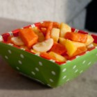 Tropical Island Fruit Salad - Simply tossing together cut pineapple, mango, papaya, and bananas can deliver a tropical taste to your table.