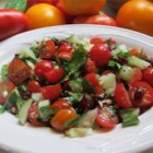 Cherry Tomato Salad - Pine nuts are a  special treat in any salad, but the other ingredients are swell too - tomatoes, spring onions and black and green olives. It 's tossed with vinaigrette and chilled.