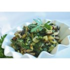 Savory Swiss Chard with Portobellos - Portobello mushrooms and leek stud this Swiss chard side dish covered with Parmesan cheese.
