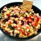Amy's Creamy Black Bean Corn Salsa - Black beans and corn are tossed with a creamy, spiced dressing creating an addictive salad perfect for any summer get-together.