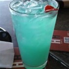 Blue Hawaiian Cocktail - Invented in Hawaii in the 1950s, the Blue Hawaiian will have you crooning like Elvis.