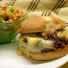 Kickin' Turkey Burger with Caramelized Onions and Spicy Sweet Mayo - Ground turkey burgers seasoned with onions, barbecue sauce, liquid smoke and spices are topped with a spicy honey mustard mayo and caramelized onions.