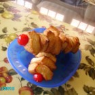 Monkey Bread Kabobs - Thread cinnamon and sugar-coated biscuit dough onto skewers and finish off with a maraschino cherry for a new twist on monkey bread.