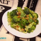 Crunchy Romaine Toss - Crunchy broccoli and romaine lettuce are tossed with an Asian-style sweet and sour dressing, then topped with ramen noodles for a refreshing salad good with any meal!