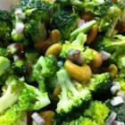 Broccoli Cashew Salad - The classic broccoli salad is made with with red onion, bacon and cashews. This is perfect for a party or potluck.