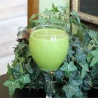 Green Monster Smoothie - Banana, spinach, and peanut butter blend with yogurt and milk for a power-packed smoothie.