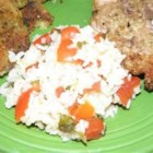 Flavorful Rice - A savory recipe for your rice steamer!  Combines white rice with basil, oregano and tomatoes.