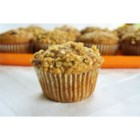 Pumpkin Muffins with Streusel Topping  - Moist and hearty pumpkin-oat muffins are topped with a brown sugar and oat streusel perfect for a quick breakfast or a holiday brunch.
