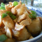 Springfield Cashew Chicken - This version of cashew chicken fries the chicken in peanut oil and covers it with an oyster sauce-based sauce. It's served with a sprinkling of cashews and green onions.
