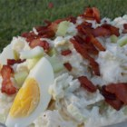 Bacon Potato Salad - Family Legacy - Potatoes, hard-boiled eggs, and bacon are folded together with a creamy, mayonnaise-based dressing in this tried and true side dish.